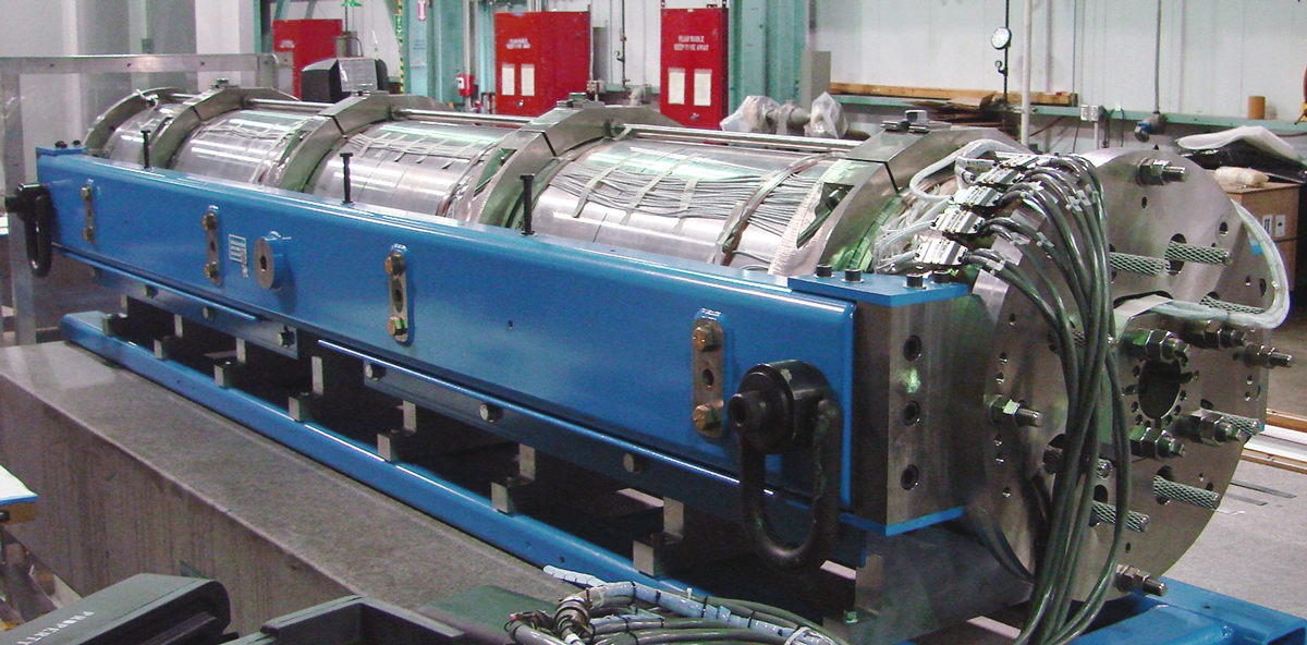 The completed long quadrupole shell magnet (LQS01) in the Building 77A assembly area of Berkeley Lab's Engineering Division.