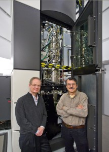 Berkeley Lab director Paul Alivisatos (left) and physicist Alex Zettl at TEAM I, the world's most powerful electron microscope, where a they led a collaboration that produced the first atomic-scale, real-time movies of nanocrystal growth in liquids. (Photo by Roy Kaltschmidt, Berkeley Lab)