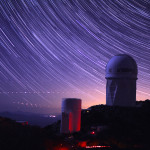 Star trails take shape around Kitt Peak National Observatory in this long-exposure image. The 4-meter Mayall telescope building, at right, now houses Mosaic-3, a new infrared camera built by a collaboration that includes Berkeley Lab scientists. (Photo credit: P. Marenfeld and NOAO/AURA/NSF)