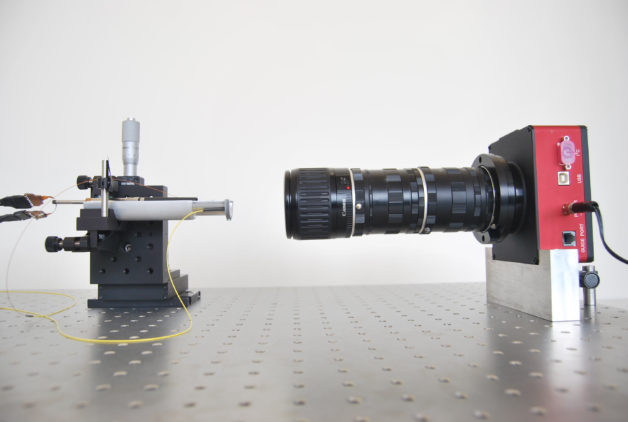 Photo - A camera test of a robotic fiber-optic positioner that will be tested in ProtoDESI. (Credit: MNRAS, DOI: 10.1093/mnras/stv541)