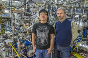 Eryin Wang (left)and Alexei Fedorov at ALS Beamline 12.0.1 where the induced high temperature superconductivity in a topological insulator was confirmed. (Photo by Roy Kaltschmidt)
